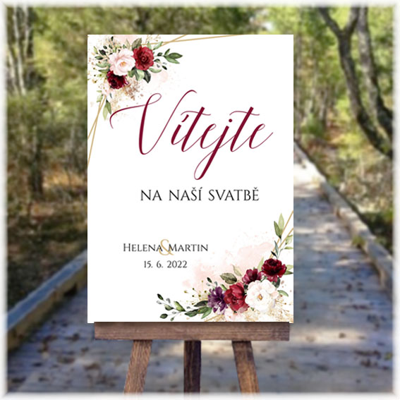 Wedding welcome sign with red flowers