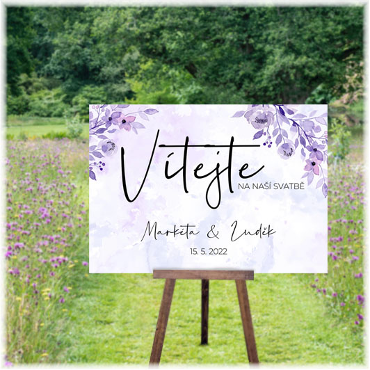 Welcome wedding sign with purple flowers