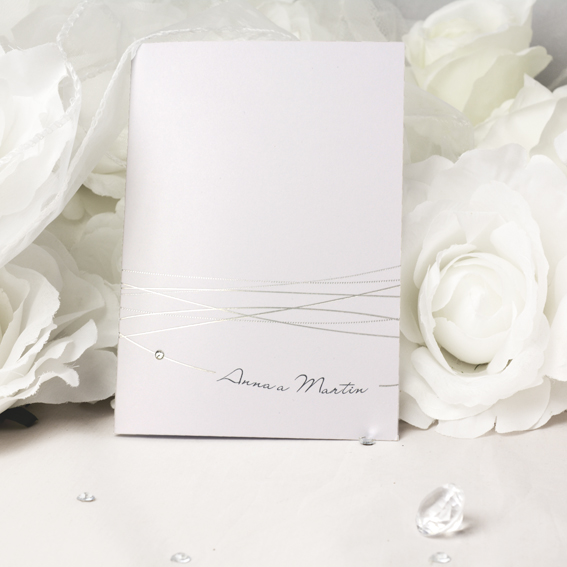 Wedding invitation with shiny silver embossing string adorned with rhinestones