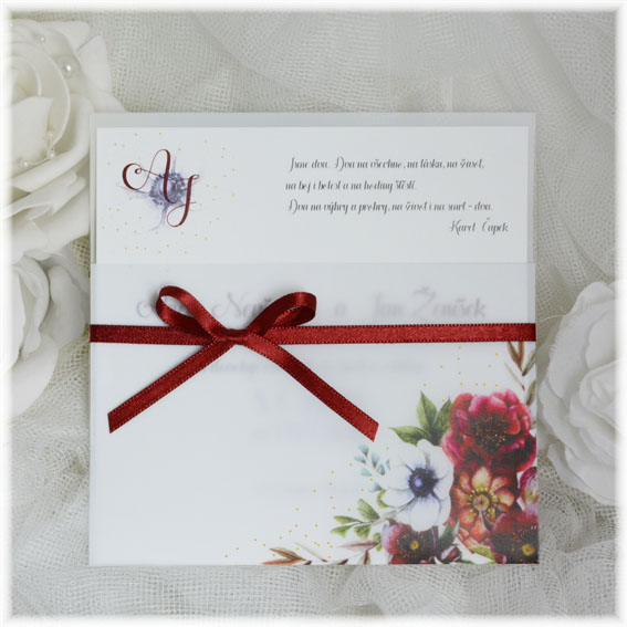 Wedding invitation made from transparent pocket with flowers and tied with a bow